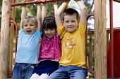 stock photo of children playing  - happy sister with brothers on a playground - JPG