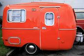 picture of travel trailer  - bright orange restored antique mini travel camper - JPG