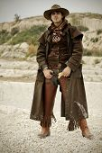 foto of wild west  - handsome man in cowboy clothes - JPG