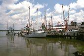 stock photo of katrina  - shrimp boats on the back bay of biloxi mississippi - JPG