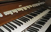 stock photo of organist  - two manual organ showing stop tabs and pistons - JPG
