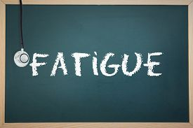 picture of fatigue  - The word fatigue and stethoscope against chalkboard - JPG