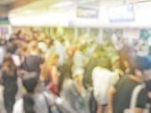 Blurred Image Of Crowd Of Anonymous People Standing And Waiting At Indoor Train Station In Rush Hour poster