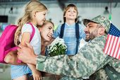 Family And Man In Military Uniform poster