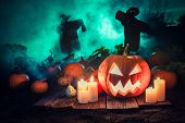 Spooky Pumpkin With Green Mist And Scarecrows For Halloween poster