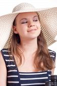 A Girl In A Big Straw Hat