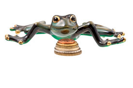 stock photo of obeah  - ceramic frog and coins isolated on white - JPG