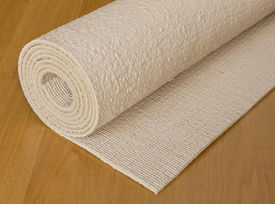 stock photo of yoga mat  - rolled up execise mat used for yoga or pilates - JPG