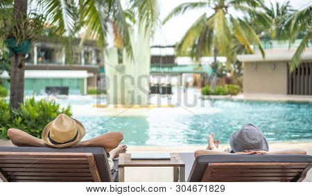 poster of Summer Resort Hotel Stay Relaxation With Tourist Traveller Couple Take It Easy Happily Resting On Be