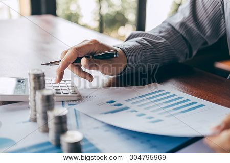 poster of Businessman Accountant Counting Money And Making Notes At Report Doing Finances And Calculate About