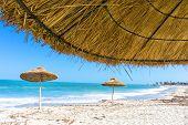 Landscape Of Parasols On The Beach Of Djerba In Tunisia poster