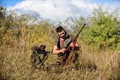 Man With Rifle Hunting Equipment Nature Background. Recharge Rifle Concept. Hunting Equipment And Sa poster