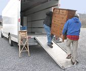 stock photo of moving van  - Two men carry chest of drawers onto a moving van - JPG