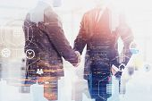 Two Unrecognizable Businessmen Shaking Hands Over Cityscape Background With Double Exposure Of Digit poster
