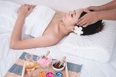Female Relaxing Massage At Spa Wellness Center. Beautiful Woman Lying On Spa Bed. Young Asian Girl E poster