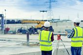Civil Engineering Flying Drone Over Construction Site Survey For Land And Building Project. poster