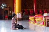 Thai Buddhism People In Buddhist Pray For Benefaction Worship To Buddha At Chinese Temple Under The  poster