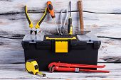 Tool Box And Various Tools On Wooden Background. Adjustable Wrench, Tape Measure, Screwdriver, Plier poster
