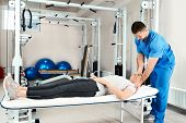 Physiotherapist Working With Patient In Rehabilitation Center poster