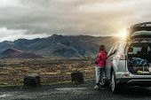Woman Tourist Travel By Suv Car In Iceland. poster