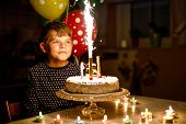 Adorable Happy Blond Little Kid Boy Celebrating His Birthday. Child Blowingcandles On Homemade Baked poster