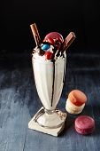 Crazy Milkshake or Freakshake with Chocolate Treats, Macaroons and Colorful Sweets Mix in Tall Glass poster