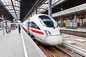 stock photo of tram  - high speed train in classicistical station in Wiesbaden - JPG