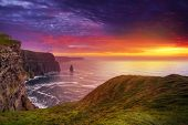 stock photo of cliffs moher  - Idyllic Cliffs of Moher at sunset - JPG