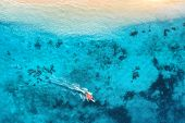 Aerial View Of The Fishing Boat In Clear Blue Water At Sunset In Summer. Top View From The Air Of Bo poster