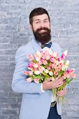 Romantic Gift. Macho Getting Ready Romantic Date. Tulips For Sweetheart. Man Well Groomed Wear Blue  poster