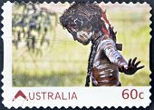 stamp printed in Australia shows Australian Aboriginal Child with skin painted in  traditional way