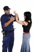 foto of shoplifting  - A male security officer handcuffs a female - JPG