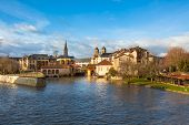 The Moselle River Flows Through The Ancient Town Of Metz, France