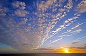 stock photo of stratus  - Stratus Clouds at Sunset in the English Channel in Early Fall - JPG
