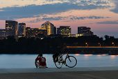 stock photo of rosslyn  - Cyclist silhouette and Rosslyn skyscrapers at sunset in Washington DC  - JPG