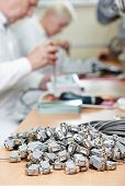 stock photo of microchips  - Technology process of microchip device assembling at manufacture - JPG