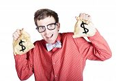 pic of year end sale  - Excited male accountant holding money bags with dollar signs in a tax return concept on white background - JPG