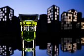stock photo of absinthe  - Absinthe shot in nice colorful cityscape setting - JPG