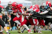 INNSBRUCK,  AUSTRIA - MAY 25 DB Chris James (#44 Raiders) tackles RB Alexander Kuronen (#36 Roosters