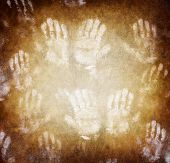 Imprint of human hands, brown grunge background, conceptual image of war and poverty, need help conc