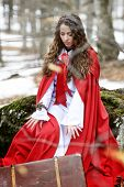 foto of cloak  - beautiful woman with red cloak in the woods - JPG