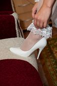 stock photo of garter  - White garter bride on foot - JPG