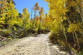 stock photo of colorado high country  - country road through colourful Colorado during foliage season - JPG