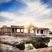 stock photo of vijayanagara  - Ancient ruins of Vijayanagara Empire at sunset blue sky in Hampi Karnataka India - JPG