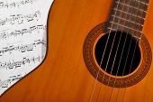 pic of musical scale  - A classical guitar and a music sheet - JPG