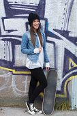 Young Fashionable Happy Brunette Skateboarder Girl