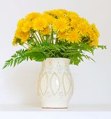 Bouquet Of Dandelions In A Jar