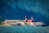 Vintage retro hipster style travel image of St. Bartholomew's Church, Berchtesgaden, Bavaria, German