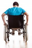 stock photo of paralympics  - A backside of a man driving a wheelchair - JPG