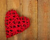 pic of heartfelt  - Red heart on a background of wood - JPG